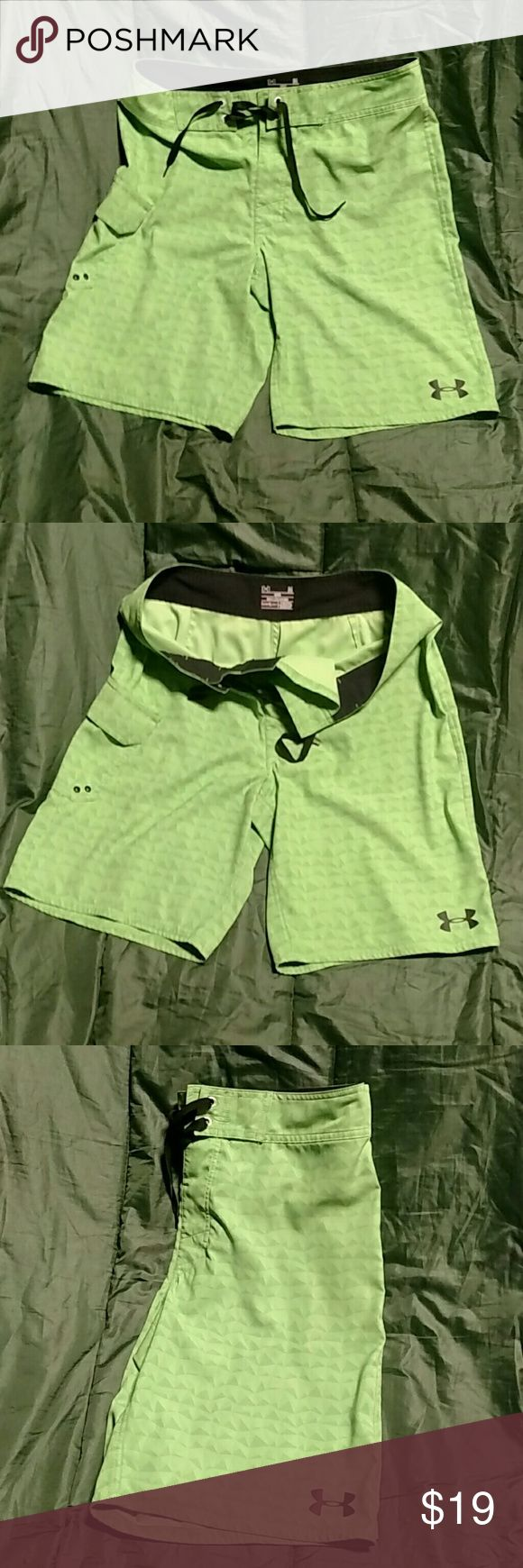 Men's swimsuit Men's pistachio colored swimsuit with distinctive design ,right hand side pocket with a Velcro flap hits at the knee,size 34 fits like a size 32 ,ties in the front.Thank you🌴🌴🌴 Under Armour Swim Swim Trunks