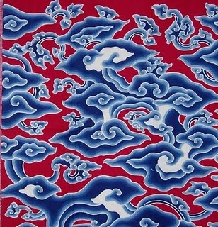 This is mega medung style batik. It's from the north west of Java and tends to be fairly colourful. The batik makers up there were influenced heavily by Chinese traders, so that's why this design has strong Chinese influence.