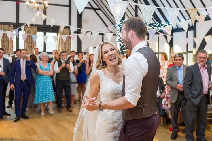 Photo of bride and groom in the Chilham Village Hall, Kent. First dance. Photo by Mugshot Photography