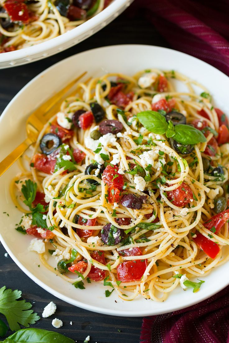 Made with tender spaghetti, fresh tomatoes, zesty olives, tangy feta, plenty of fresh herbs and finished with a robust garlicky olive oil. So delicious!