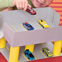 Car garage using cereal boxes and cardboard tubes