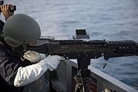 160630-N-XG464-443 ATLANTIC OCEAN (June 30, 2016) Logistics Specialist 2nd Class Michael Lubig, fires an M240 machine gun during a live-fire exercise aboard the Arleigh Burke-class guided-missile destroyer USS Cole (DDG 67). Cole is conducting routine training and operations in preparation for its upcoming deployment with the George H.W. Bush Strike Group. (U.S. Navy photo by Mass Communication Specialist 2nd Class Jonathan B. Trejo/Released)