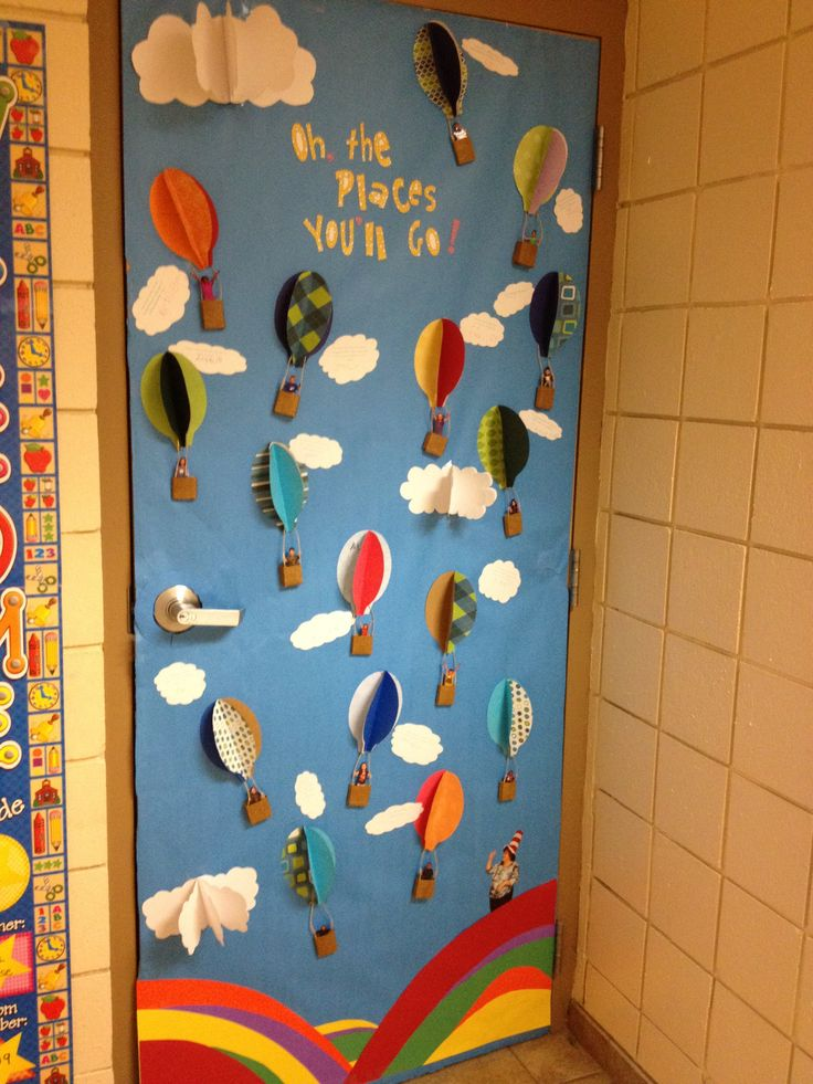 """""""Love of Reading"""" Classroom Door Decorating Contest. Inspired by Dr. Seuss' """"Oh, the Places You'll Go."""" Clouds feature students' quotes about dream jobs, vacations, etc. Pics of students inside hot air balloon baskets."""