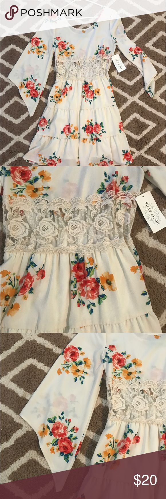 Gorgeous floral dress Cute floral sundress! Never worn, new with tags! Front of the dress has lace, see through cutout. Bottom half of dress is lined. Dresses