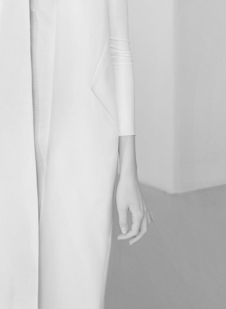 Clean detailed shot, strong linear composition. Minimal White Coat - minimalist style, sleek white simplicity // NON