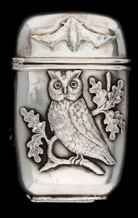 Shiebler sterling silver match case or vesta, retailed by Tiffany, with owl and bat motifs on one side, and octopus and fish motifs on the other. c1880 (Heritage Auctions) (A)