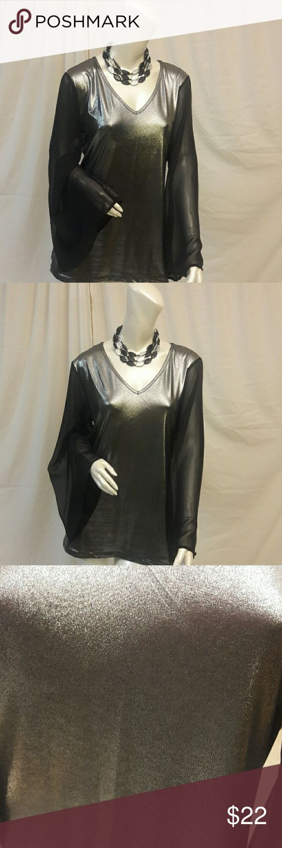 PLUS SIZE Metallic blouse with Sheer sleeves Silver metallic blouse with black silky bell shapes sleeves. Perfect for a night on the town! Ashley Stewart Tops Blouses