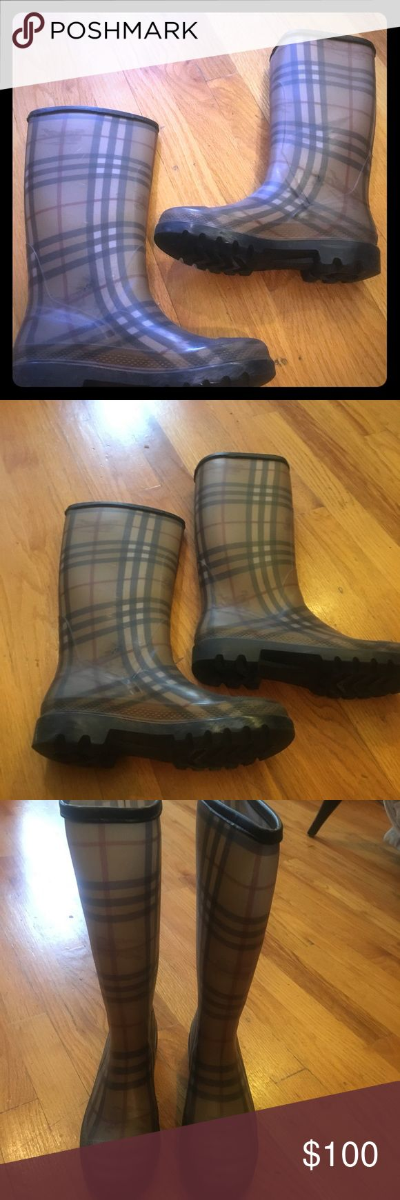 Burberry Rainboots Classic Burberry Rain Boots with Black Leather Trim. Great rubber soles! Burberry Shoes Winter & Rain Boots