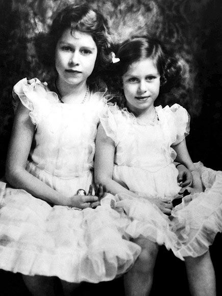 """Princesses Elizabeth (nicknamed """"Lilibet"""" by her family) and Margaret sit for a portrait in 1937. The girls had just recently learned Elizabeth was to become queen some day: Their uncle, Edward VIII, had just abdicated in December 1936 to marry American divorcée Wallis Simpson on Dec. 11, 1936, leaving their father, King George VI, to ascend the throne.: Queen Elizabeth, England, Elizabeth Nicknames, Early Photo, Elizabeth Ii, Elizabeth Early, Royals Families, Diamonds Jubilee, Princesses Elizabeth"""