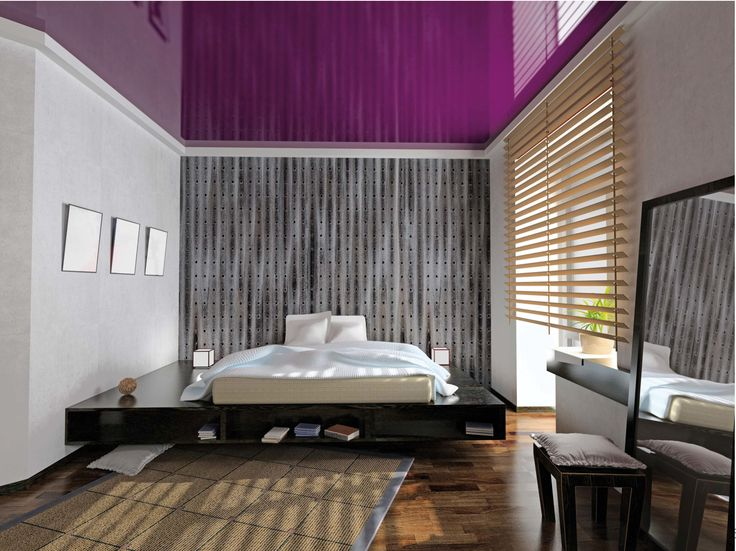 Bright purple lacquer stretch ceiling in a bedroom.