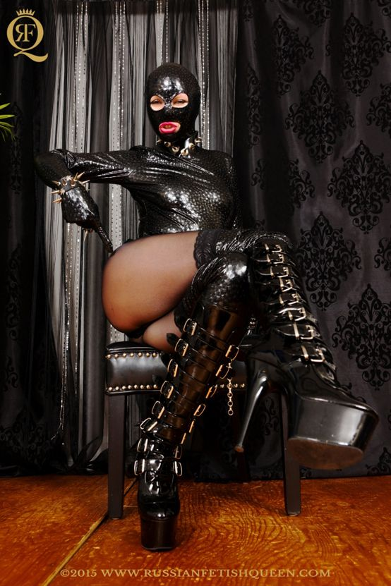 #RussianFetishQueen dressed in #PVC #mask and #outfit, #glossypantyhose, wearing a #leather #overkneeboots
