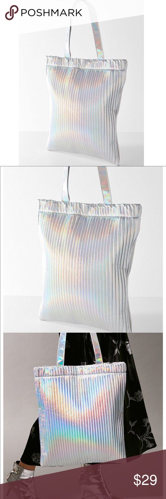 URBAN OUTFITTERS PLEATED TOTE BAG IN METALLIC URBAN OUTFITTERS PLEATED TOTE BAG IN METALLIC when that minimalist lifestyle just isn't cutting it, pile all your necessities into this seriously luxe, pleated tote bag. With its bright metallic colors! Perfect for festivals, raves, etc. Roomy tote in a luxe velvet with an open silhouette and inner lining. Two pockets inside one zipper to keep belongs safe, complete with sturdy, thick carrying handles. Content + Care - PVC, polyester - Wipe clean…