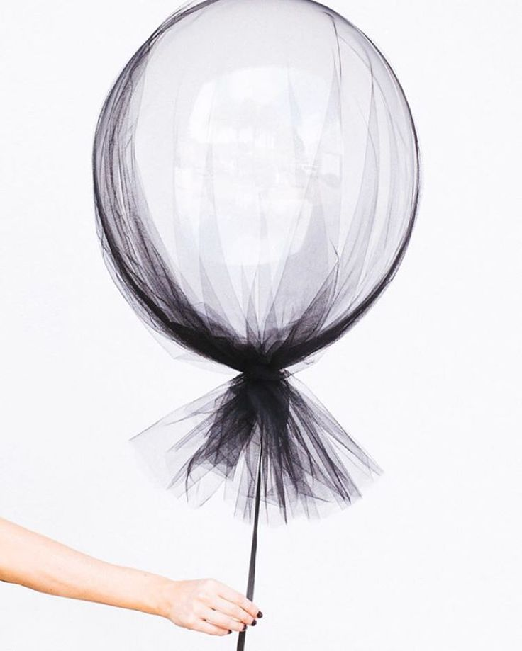 Tulle over a large transparent balloon + satin ribbon