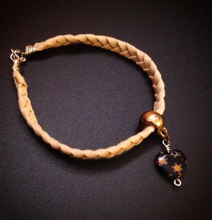 handmade braided bracelet, black heart https://www.facebook.com/xtworld?ref=hl