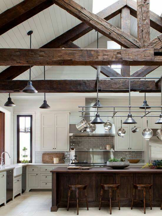 Vaulted skylight ceiling with whitewashed shiplap ceiling and exposed beams.