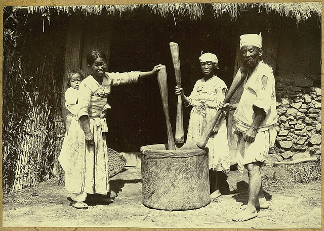 [Peasant pounding rice] Korea, ca. 1904 | Three farmers take turns to pound rice with mallets. The rice batter is used to make rice cakes which are special treats for parties and memorial services for ancestors.