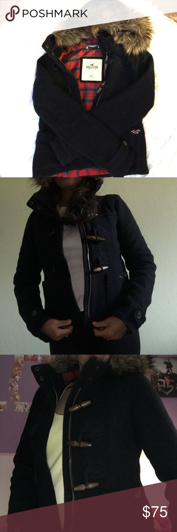 Hollister coats with hoodie XS very cute and cozy also nice and warm , navy blue, wore once. Plaid inside , fur hood Hollister Jackets & Coats Jean Jackets
