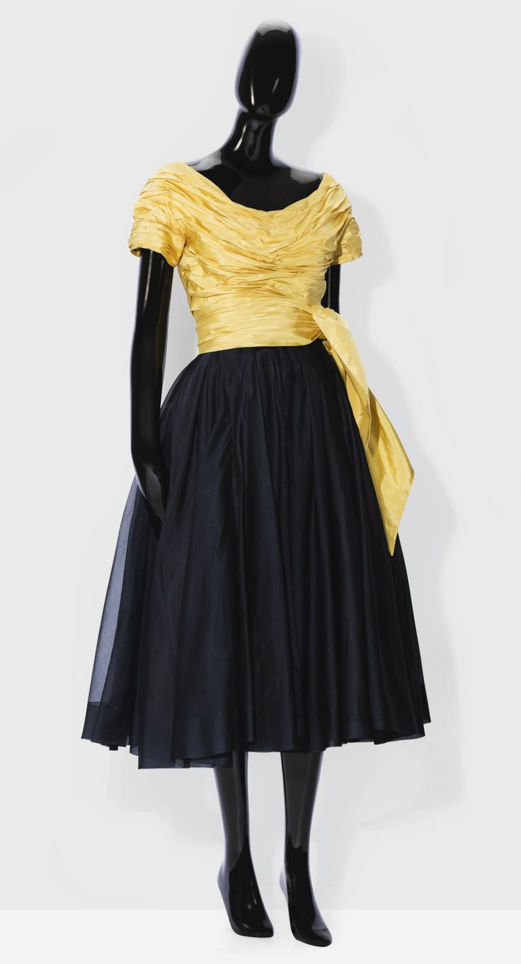 Marcel Rochas Haute couture, 1953. A cocktail ensemble with a draped yellow taffeta bodice over a midnight blue organza skirt