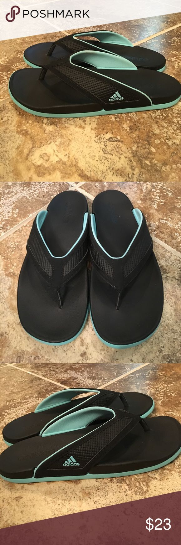 Adidas Adilette Thong Flip Flop Sandals, Size 7 Adidas Adilette Thong Flip Flop Sandals, Size 7. Features Adidas Cloud Foam footbed (similar to memory foam). Black and aqua blue. Worn once and in excellent condition. Feel free to make an offer! adidas Shoes Sandals