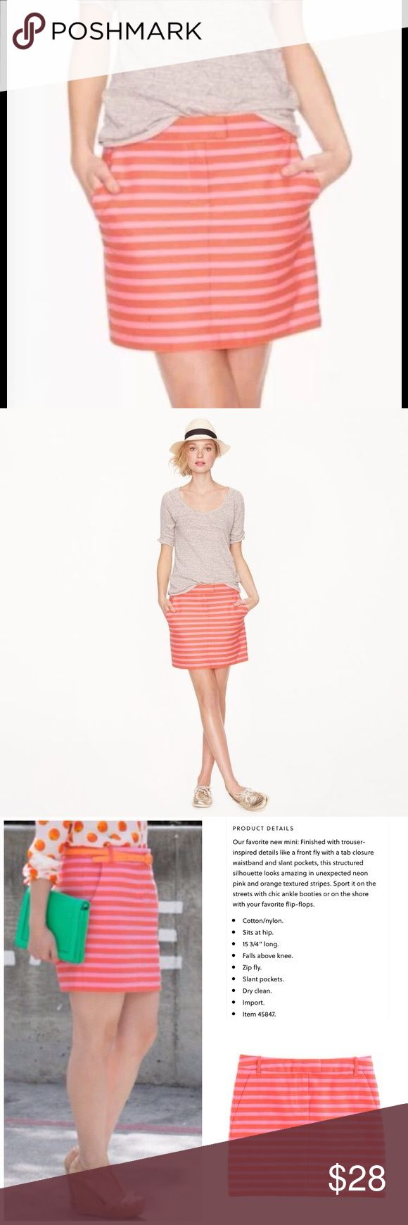 """NWT J Crew Ladies Sz 4 Postcard Mini Skirt Striped Our favorite new mini: Finished with trouser-inspired details like a front fly with a tab closure waistband and slant pockets, this structured silhouette looks amazing in unexpected neon pink and orange textured stripes. Sport it on the streets with chic ankle booties or on the shore with your favorite flip-flops. Textured stripes.  Cotton/nylon. Sits at hip. 15 3/4"""" long. Waist is 31 in. Zip fly. Slant pockets. J. Crew Skirts"""