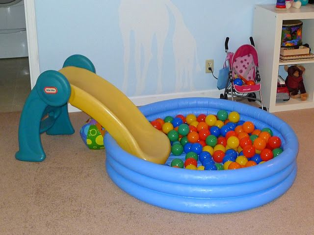 Clever idea! (Would be great for play-dates, also!) --Add a slide to that indoor swimming pool filled with those plastic balls!---First Birthday Gift Ideas...that last! from Fun at Home with Kids