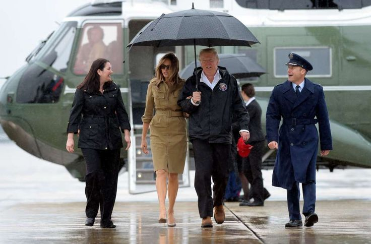 Trump faces pair of double-barreled crises at home and abroad  -  September 3, 2017:    President Donald Trump and first lady Melania Trump walk towards Air Force One at Andrews Air Force Base in Md., Saturday, Sept. 2, 2017. The President is heading to Houston and Lake Charles, Louisiana to survey Harvey's devastation.