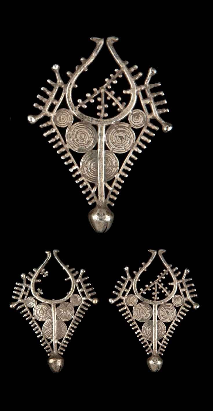 Indonesia - Lesser Sunda Islands, West Timor | Pair of earrings ~ kavata ~ from the Tetum people; silver, lost wax technique. c. 20th century. // ©Quai Branly Museum. 70.2001.27.770.1-2
