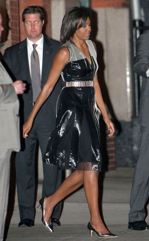 Modern Maiden from Michelle Obama's Best Looks  The FLOTUS leaves the Greenwich Hotel in New York after a fundraiser wearing a shiny, black V-neck dress with metallic belt and shoes. Modern and gorgeous!