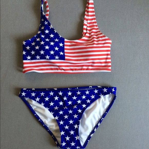 American Flag Bikini Xhilaration American flag bikini. Both top & bottom are a medium. Strappy open back. New, no tags, bottoms still have lining. Xhilaration Swim Bikinis