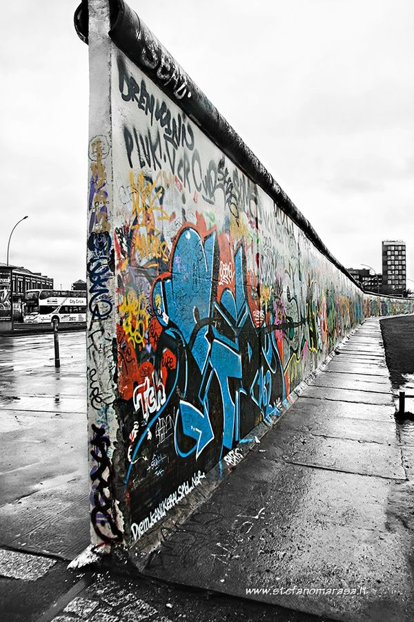 See the past meet the present at the Eastside Gallery, a remaining part of the Berlin wall covered in graffiti.