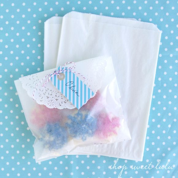 Paper Doilies over vellum bags