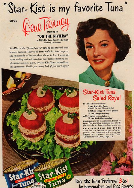 1951 Star-Kist was Gene Tierney's favorite tuna. | Star-Kist Tuna Salad Royal: In a salad bowl combine: 1 can Star-Kist Tuna (solid pack or chunk style); 2 tbsp. chopped sweet pickle; 1/4 cup chopped celery; Add: 1 tbsp. lemon juice; 1/4 cup Kraft mayonnaise | Toss together. Season to taste. Peel and slice tomatoes into thirds, placing mixture between slices as shown.