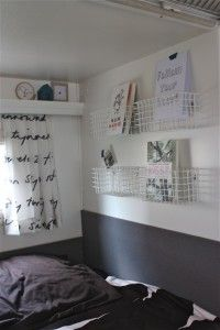 Camper renovation: wire baskets for storage, shelf above the window valence