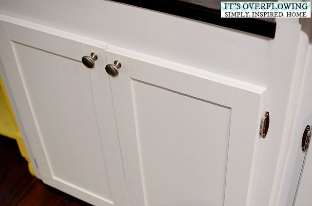 One day, we're going to redo our kitchen cabinets like this... perfect inexpensive solution for ugly outdated doors.