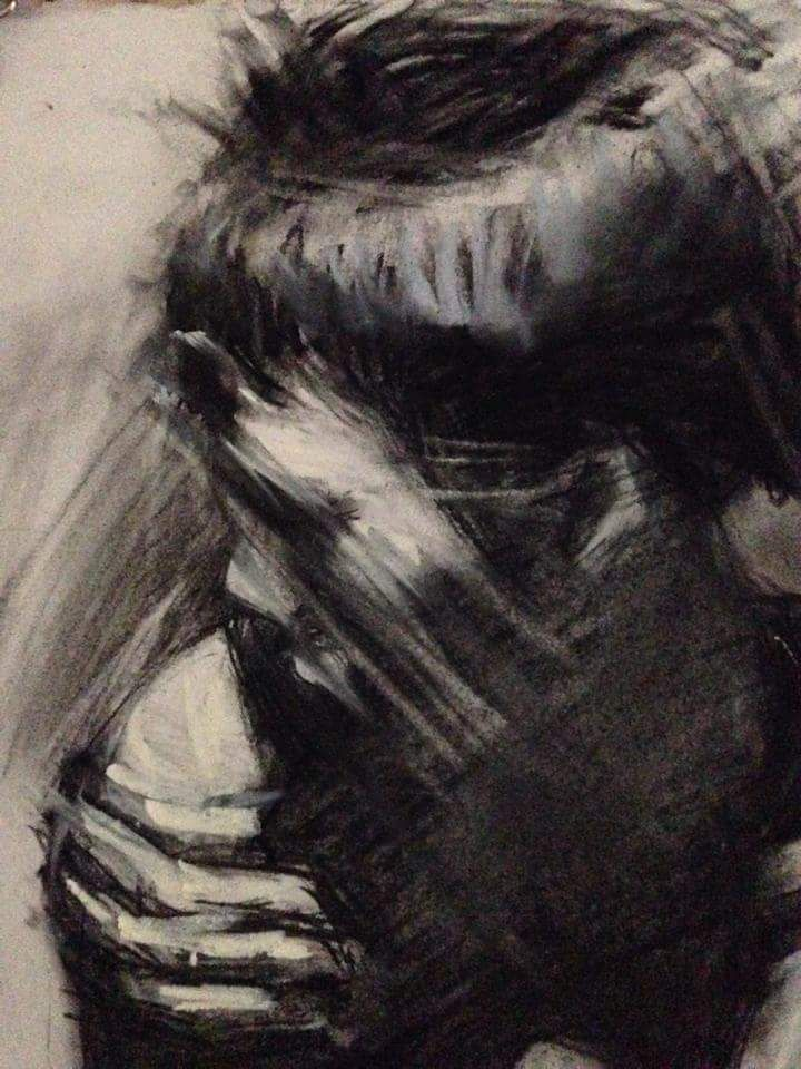 Self portrait in charcoal pencil