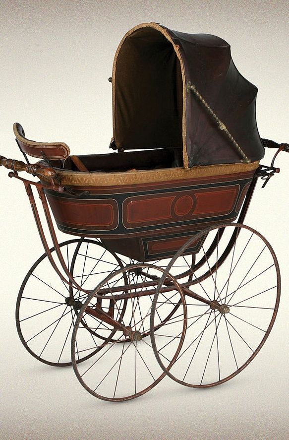 An antique wood and steel pram by British manufacturer Silver Cross. #EuropeanAntiques #Prams