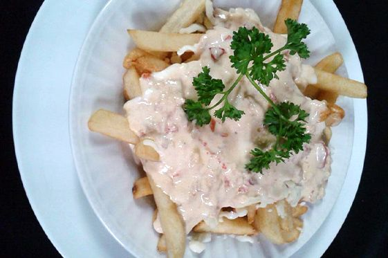 UNIQUE LOBSTER DISHES IN #NOVASCOTIA... AND WHERE TO FIND THEM! Red Cap Motel & Restaurant's lobster sauce poutine