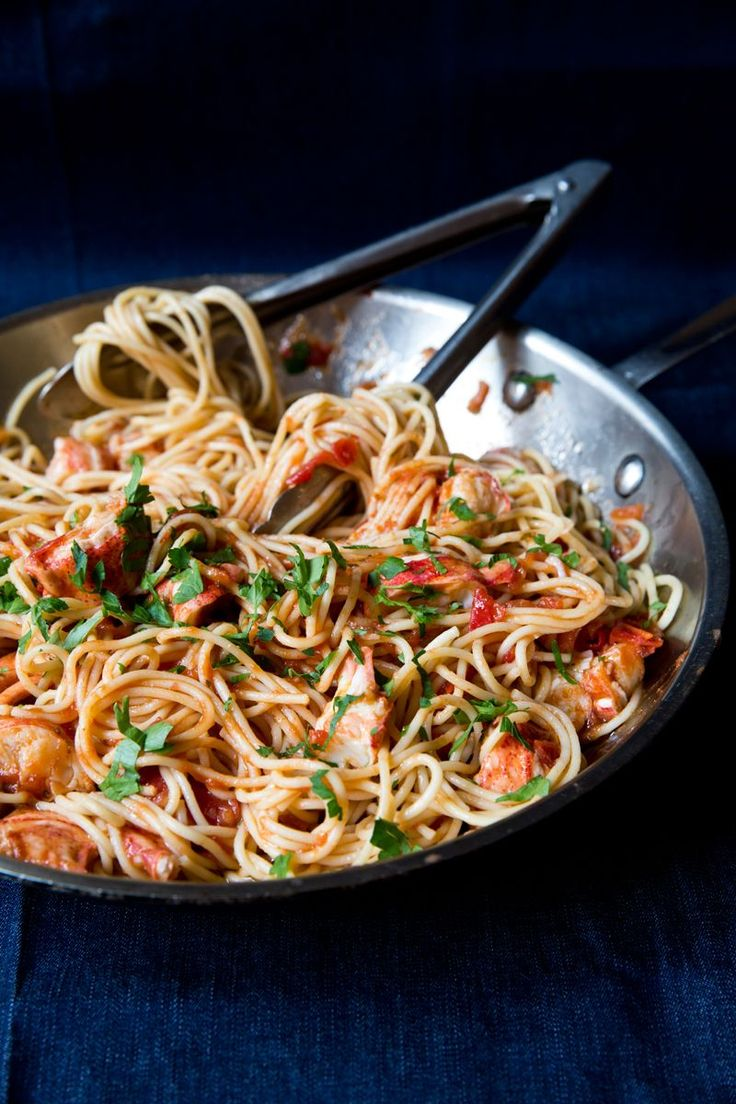 Spaghetti with Lobster: A simple Venetian dish, where pasta is tossed with garlic, fresh ripe tomatoes, and white wine.