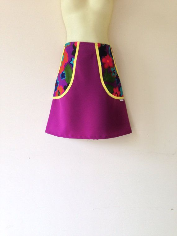 This skirt is made from a new fuschia poly/cotton and 2 huge side pockets made from retro fabric. The back of the skirt is plain pink. Australian size