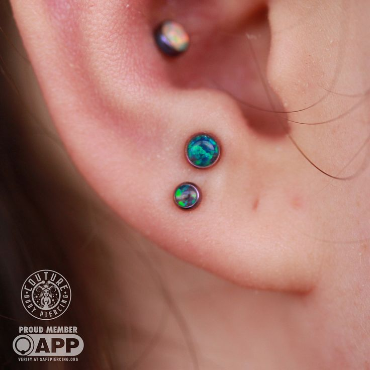 I waited almost a year for this anti-tragus to heal so I could get a picture of it  peacock Opal from @anatometalinc I'm pretty sure I did the love below it too. Can't remember. #couturebodypiercing #couturetattoo #legitbodyjewelry #appmember...