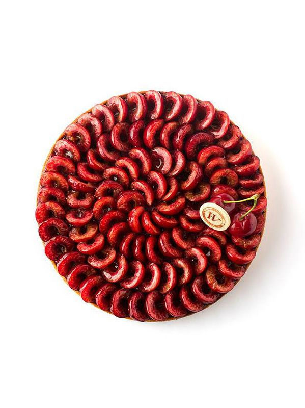 No link, but it would be easy (though time-consuming) to decorate a cake or tart with sliced cherries like this.
