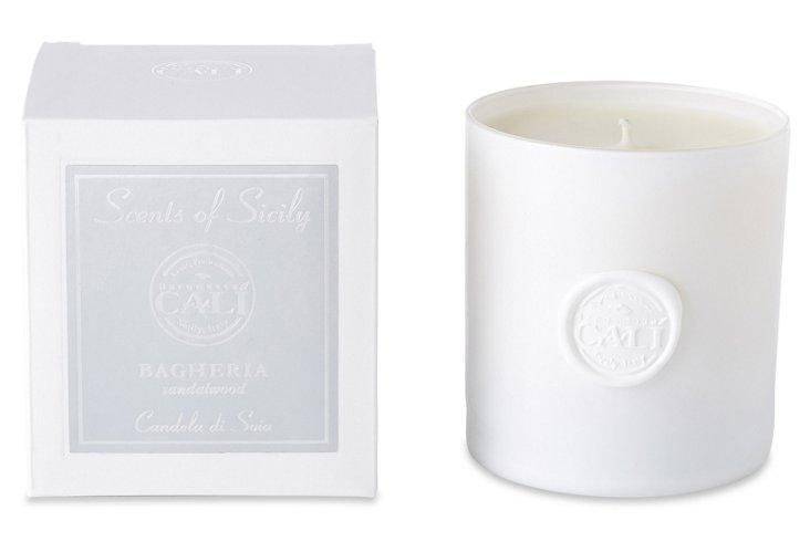 Bagheria Sandalwood Candle, White -- The warm, subtly seductive scent of sandalwood has been highly prized for centuries. This hand-poured candle, which captures its inviting fragrance perfectly, comes in a white glass vessel as alluring as its fragrance.