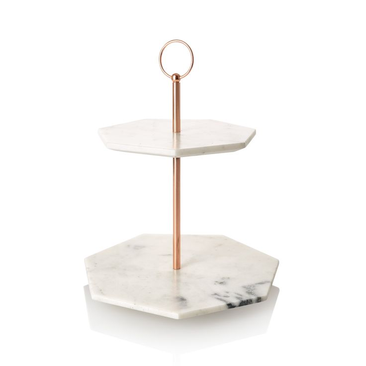 Buy the Double Tiered Marble Cake Stand at Oliver Bonas. Enjoy free UK standard delivery for orders over £50.