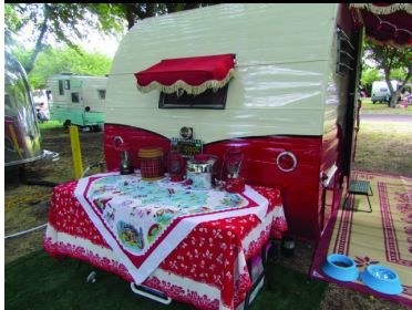 Two loves in this one--vintage campers AND linens. : )