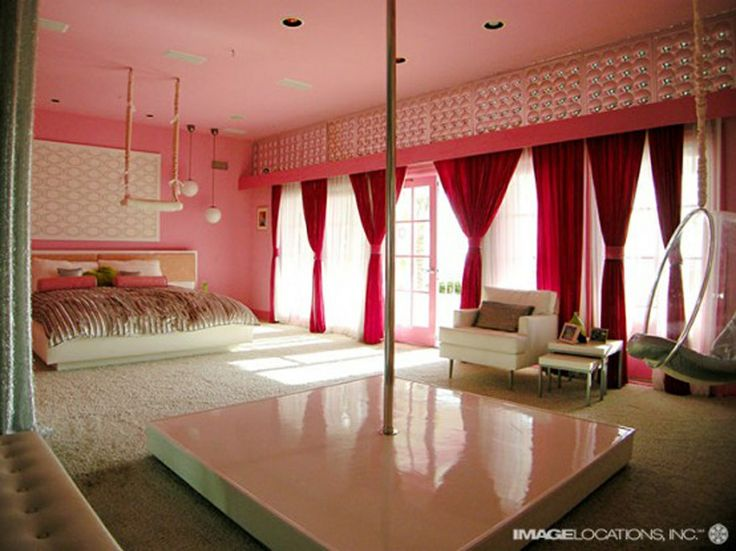Bedroom with dancing pole.