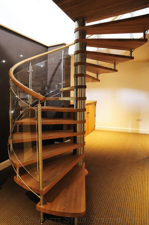 Spiral stair in a great setting with oak treads & handrail and curved acrylic panels