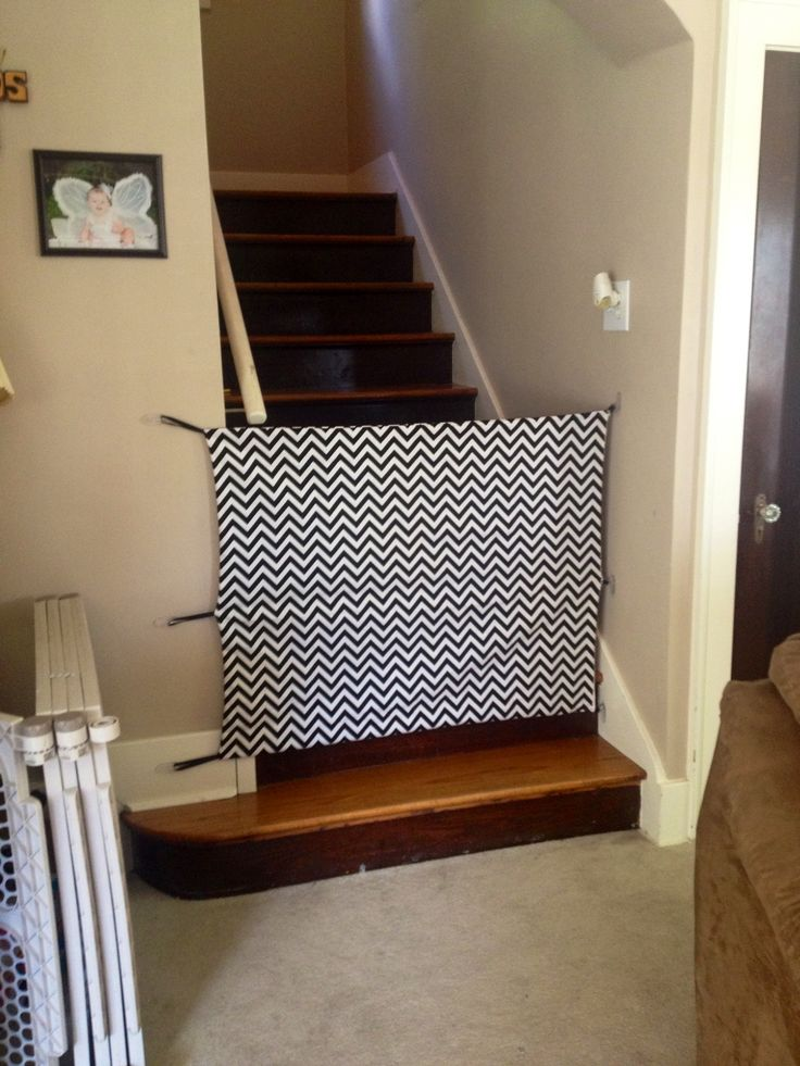 DIY fabric baby gate.  Cost around $30 total and it looks SOOO much better than a big chunky white gate and is much cheaper than a custom metal one.  LOVE how it turned out!!!