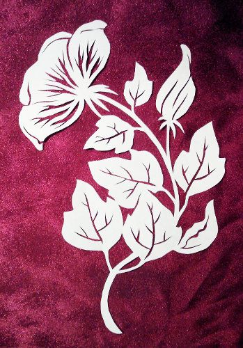 floral paper cut design | Paper cutting of a Rose of Sharon blossom with leaves. Ivory paper.