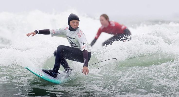 Eleven year-old Mathea Olin of Tofino competes in the women's pro/am semi-final during the Canadian Surf Championship in Tofino, British Columbia May 31, 2015. REUTERS/Kevin Light