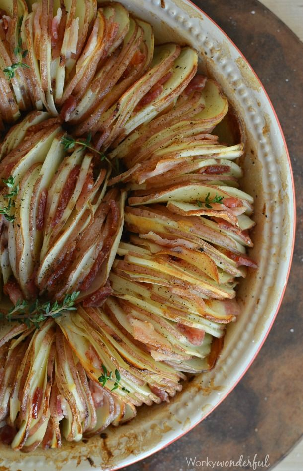 Roasted Potato Side Dish recipe made with roasted garlic, thyme, bacon and red…